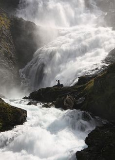 """Taken at Kjosfossen Waterfall on the train journey from Myrdal to Flåm, Norway.  We stopped for five minutes to admire and take photos of this beautiful waterfall when, suddenly, Norwegian folk music started, playing from somewhere, and this young woman just appeared and danced for us. It was all a bit surreal!"""