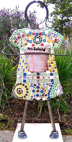 Bet you could make this from rebar structure:  Mosaic Girl Auction Idea