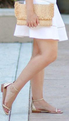 Lilly Pulitzer gold pineapple sandals, Hat Attack raffia fringe clutch, Banana Republic white jacquard skirt