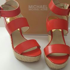 Michael Kors Posey Sandal Michael Kors Posey ankle strap sandal. Imported Vanchetta leather. 1 1/4 inch platform 4 1/2 inch heel. The color is Mandarin. Michael Kors Shoes