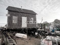 image of a old hut with boat and wooden plank. - Image of a old bricked wall hut with boat and wooden plank.