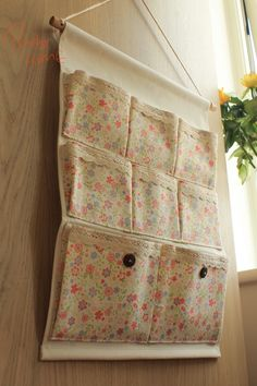 Painted Sakura Fabric hanging organiser. Lovely to have it at bedside or behind the door.