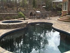 Concrete Pool - Charlotte Pool Pictures, free form design, pool decking pavers, raised spa, outdoor fireplace and outdoor kitchen