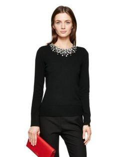 you've heard of statement necklaces…well, this is a statement sweater. slim-fitting and simple aside from the ultra-flattering embellished neckline, this is a knit you can wear (with matching cigarette pants, perhaps?) in place of a little black dress.