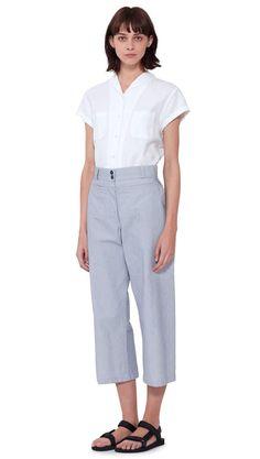 WOMEN SPRING SUMMER 2016 - White cotton airtex cap sleeve shawl collar shirt, white/blue hairline stripe cotton wide crop trouser, black nylon Teva sandal. All items MHL