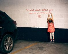 protect what's behiond you ernest zacharevic happiness brussels ambient marketing toyota 1
