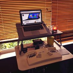 """Here's #myawesomedesk complete with Lego minifig and sea view (when the blinds are open!). It's a standing desk."""