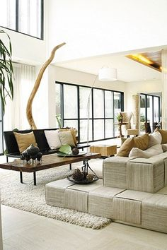 A view of the Living Area from another angle --- the space opens up the whole house. The high ceiling and open windows give the home an airy and breezy feel.