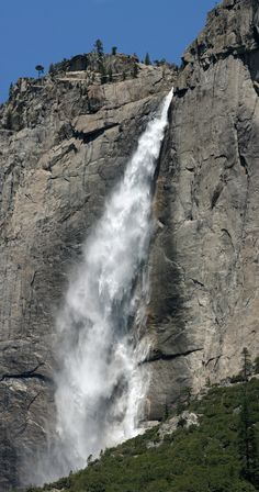 This is a series of six shots (taken with a 250 lens), stitched together taken of Yosemite falls.  The falls are amazing.  (The old chrone has been playing with Adobe Photoshop a little each night.)