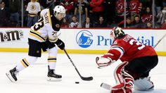NEWARK, NJ - NOVEMBER 22:  Charlie McAvoy #73 of the Boston Bruins scores the game winning goal in an overtime shootout against Cory Schneider #35 of the New Jersey Devils on November 22, 2017 at Prudential Center in Newark, New Jersey.The Boston Bruins defeated the New Jersey Devils 3-2 in an overtime shootout.  (Photo by Elsa/Getty Images)