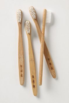 year's supply of toothbrushes - environmentally friendly bamboo.. love it!! love the natural look... could display them all in a cup .. for guests who forget their toothbrush... clever way to remind yourself to change your toothbrush too... by motnth