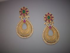 Indian Jewellery and Clothing: Elegant earrings from Kushal's fashion jewellery. Indian Wedding Jewelry, Indian Jewelry, Bridal Jewelry, Emerald Jewelry, Gold Jewelry, Jewelery, Gold Earrings Designs, Earings Gold, Temple Jewellery