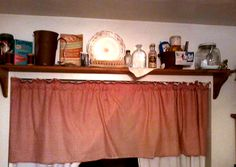 Shelf above the laundry area in the kitchen. Many items are vintage.