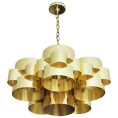 1970s Brass Cloud Chandelier by Curtis Jere | From a unique collection of antique and modern chandeliers and pendants  at https://www.1stdibs.com/furniture/lighting/chandeliers-pendant-lights/