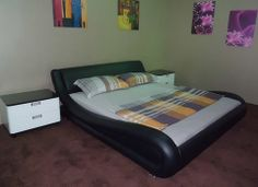 The Avenue bed combines craftsmanship with today's modern trend. This full genuine leather platform bed would complement any modern bedroom. It features a slatted bed frame and eliminates the need for a box spring.  Features:  Full Genuine Leather Queen or King Size Includes a Serta Mattress