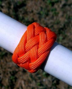 This video tutorial will show how to tie a Gaucho knot using a length of paracord. This Gaucho knot starts off with tying a 5 lead 4 bight Turk's Head knot, then working from that into a Gaucho knot. This decorative knot can be tied onto a cane, walking stick, hiking staff, used as a neckerchief slide/woggle for a scout, added to a flashlight, knife handle, sheath, fishing pole, etc. As with other Turk's Head knots and their variations, you may find yourself l...
