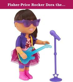 """Fisher-Price Rocker Dora the Explorer Doll. Inspired by the special television episode, """"Dora Rocks!"""" Dora is dressed in a sparkly pink skirt, purple leggings and a matching jacket! She also comes with rock-star sunglasses, a blue guitar and a microphone stand. With glittering lights and catchy songs, Dora really puts on a sparkling performance! Dora talks in English and Spanish and sings two special songs! She'll even ask your little star to sing along with her! Kids can dance and clap…"""