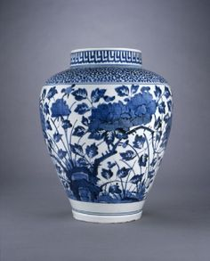 Jar with chrysanthemums and peoniesside