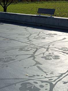 Etched concrete. Pretty public realm - Normand Park, London.