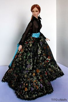 Long skirt with blue sash, topped with a shear or chiffon blouse