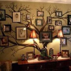 What an unique wall and family tree   Could also incorporate this theme for a wedding and branch the families together and make it a white tree.
