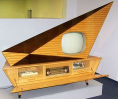 """This stereo console made by the German company Kuba is too good for words. The styling is amazing. This """"Tango"""" console was made sometime between 1959 – 1962."""