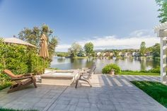 Westlake Village home with spectacular lake and mountain views. This gorgeous 3 bedroom, 3 bath, contemporary home has been completely remodeled from the bottom up. Gourmet kitchen, new quartz countertops, center island which also serves as a breakfast counter, wine cooler, beautiful wood cabinets, stainless steel appliances, great room, dining area and living room with fabulous floor to ceiling fireplace. Beautiful engineered wood flooring and recessed lighting. All baths have new quartz…