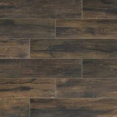 Boost up a distinctive flair to your home with the addition of this excellent Florida Tile Home Collection Smoked Hickory Porcelain Floor and Wall Tile. Wood Grain Tile, Faux Wood Tiles, Wood Tile Floors, Wood Look Tile, Porcelain Vs Ceramic, Porcelain Floor, Home Depot Flooring, Commercial Flooring, Style Tile