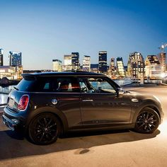 When the city lights up, seize a skyline view. [MINI Cooper S Hatch fuel consumption combined: - emission combined: 136 - 133 g/km] Mini Cooper 2017, Blue Mini Cooper, Bentley Continental Gt Speed, City Car, First Car, City Lights, Light Up, Dream Cars, Skyline