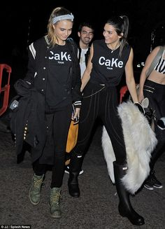 Twin day: Kendall, 19, and Cara, 22, coordinated in Cake Tour shirts as they chatted away ...