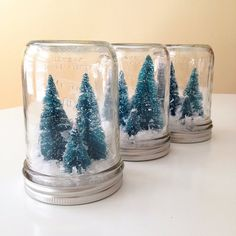 A pint size jar is filled with frosty green bottle brush trees and fluffy white snow to create a festive winter wonderland. Pair it with other A JAR items to create a snowy winter scene. Also available in a small half pint size. Mason Jar Christmas Decorations, Christmas Mason Jars, Noel Christmas, Homemade Christmas, Winter Christmas, All Things Christmas, Hall Decorations, Winter Decorations, Christmas Wishes