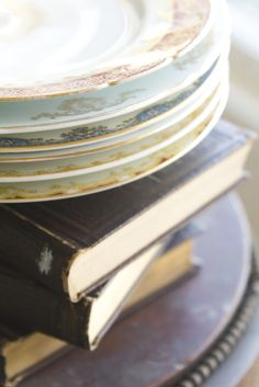 old books + mismatched china create easy vintage style