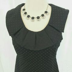 Gorgeous! Subtle polka dot a-line dress Gorgeous black polka dot dress with a-line skirt and ruffle collar. Fully lined. Merona size 2. 37 inches from shoulder to hem. Shell is 55% cotton 45% polyester. Lining is 100% polyester. Side zip. Merona Dresses
