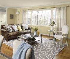 brown leather sofa, gray rug, buttermilk paint
