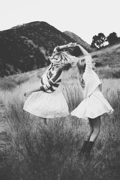 best friends | dancing | fun | fields | swirl | twirl | holding hands | black & white photography | www.republicofyou.com.au