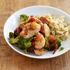 Ginger-Garlic Chicken Stir-Fry with Rice Recipe Main Dishes with boneless skinless chicken breasts, teriyaki sauce, canola oil, broccoli, red bell pepper, carrots, water chestnuts, scallions, fat-free reduced-sodium chicken broth, ginger root, minced garlic, water, sambal ulek, cooked brown rice
