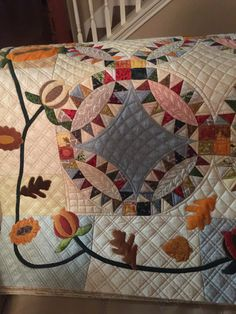 Adrean challenged herself on this quilt by quilting a basket weave behind the…