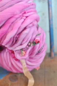 Thick and Thin Art Yarn. Made from Merino Wool and Embellished with Handmade Flowers.