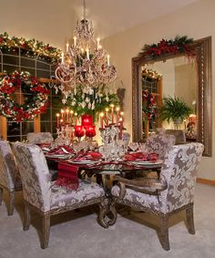 Don't like the chairs but love the wreath and garland on the window!!