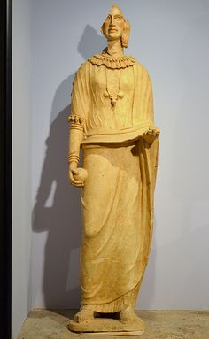 Female statue with ball Terracotta. 5th cent.BCE From the votive deposit in the sanctuary of Minerva Tritonia. Museo Archeologico Lavinium,Pomezia,Italy