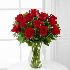 The FTD® Blooming Masterpiece™ Rose Bouquet is a classic expression of love and sweet affection! A bouquet of red roses arrive accented with lush greens all beautifully arranged in a clear glass vase. Red Rose Arrangements, Rosen Arrangements, July Flowers, Fresh Flowers, Send Flowers, Flowers For Everyone, Flower Factory, Red Rose Bouquet, Flower Bouquets