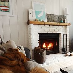 This is pretty much my idea of a perfect home on a cool fall evening - dog and roaring fire included    Image Via: Bourbon Daisy
