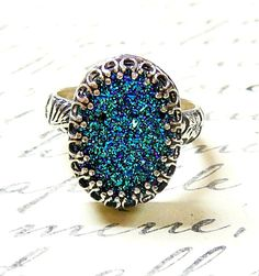 Cassandra Ring - Gothic Sterling Silver Ring with Large Oval Titanium Blue Green Drusy Quartz Druzy by EternalElementsShop on Etsy https://www.etsy.com/listing/125747877/cassandra-ring-gothic-sterling-silver