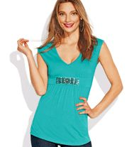 Embellished V-Neck Top in Misses Tunic-length top boasts an empire waist with beaded trim to flatter the waistline. Features v-neck and cap sleeves.