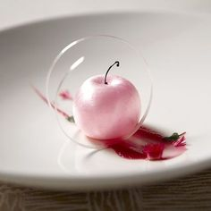Pink Pearl Apple at Sixteen, Chicago. Chef Patrick Fahy serves sorbet in a pink, apple-shaped sugar shell. The color is meant to evoke Japanese cherry blossoms and springtime. - Photo Credit: Courtesy of Sixteen Fancy Desserts, Köstliche Desserts, Plated Desserts, Delicious Desserts, Yummy Food, Food Design, Beautiful Desserts, Molecular Gastronomy, Culinary Arts