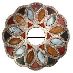 Brooch | Designer ?  Sterling Silver. Scottish agates of varied color.  c. 1860 - 1880, Scotland.