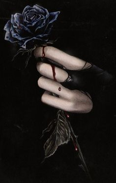 pale hand holding black rose blood dripping down onto fingers