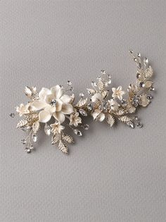 4e0c7fd9a14 Best Seller! Bridal clip features ivory enamel flowers accented with  frosted leaves and sparkling rhinestones