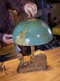 Light It Up (for Less!)  Instead of hitting the store for a run-of-the-mill lampshade, take a look at items you already have on hand. Here, half of a kids' globe makes a conversation-starting shade for a vintage lamp base. Most cardboard globes are held together with a strip of adhesive, which makes separating the halves a snap.