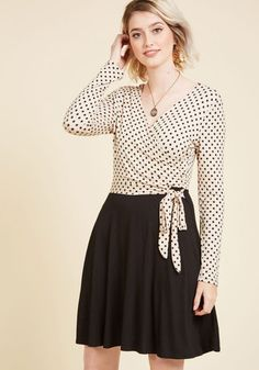 Wearing this twofer dress to the public forum, you promote your ideas with confidence. Your declarations are met with 'oohs' and 'ahhs', as each phrase emphasizes the surplice neckline, side ruching, decorative tie, and black-and-beige dotted bodice of this long-sleeved dress, concluding a successful meeting with style!